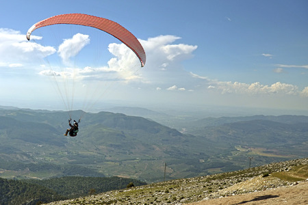 paraglider in the sky over the mountains photo