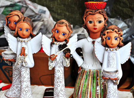 latvia girls: Christmas angels from clay in national costumes
