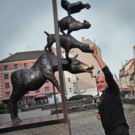 Spanish tourists and statue of the Bremen Town Musicians in Riga, Latvia photo
