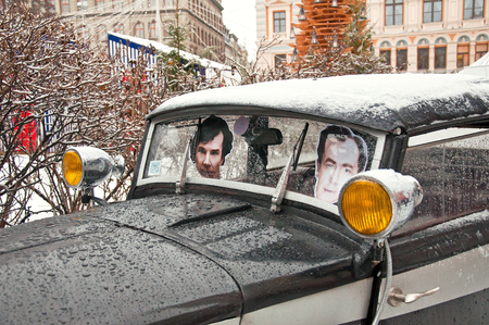 portraits of characters in the movie Conan Doyle in a retro car on the birthday of Sherlock Holmes in the streets 04.01.2015 Riga, Latvia