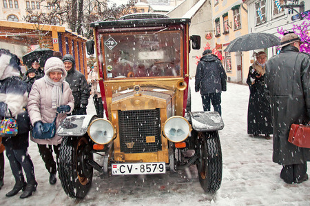 retro car and book character Conan Doyle in Riga, Latvia, 04/01/2015