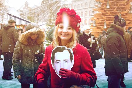 intellectually: RIGA, LATVIA - January 4: girl with a photo of the actor of books Conan Doyle Editorial