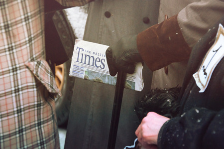 intellectually: RIGA, LATVIA - January 4: Times newspaper in the hands of the hero of books Conan Doyle Editorial