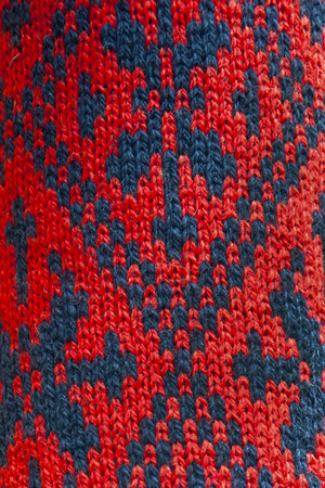 underlying: knitting pattern pattern close-up red and blue background