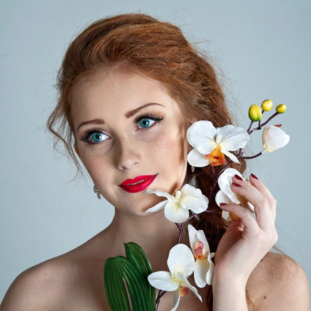 Beauty woman. Beautiful model girl with orchid. photo