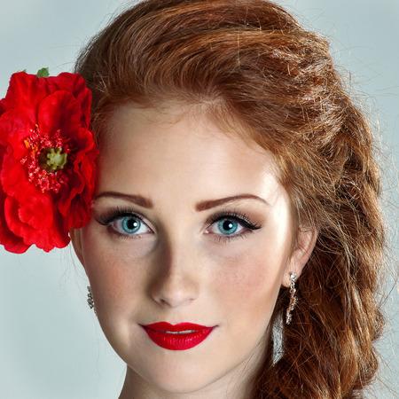Beauty woman. Beautiful model girl with poppy. photo