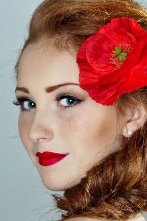 Beauty woman. Beautiful model girl with poppy. photo