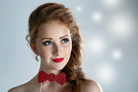 Beauty woman. Beautiful model girl with girl fake bow tie photo