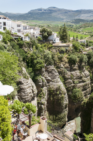 antik: Ronda, Spain - May 6, 2014. Panoramic view from a new bridge in Ronda, one of the famous white villages in Andalusia, Spain