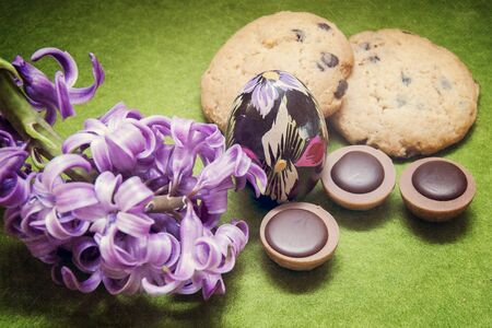 Easter composition hyacinth, cookies, candy and egg photo
