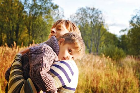 children happy: dad and son in autumn Park. Happy family.