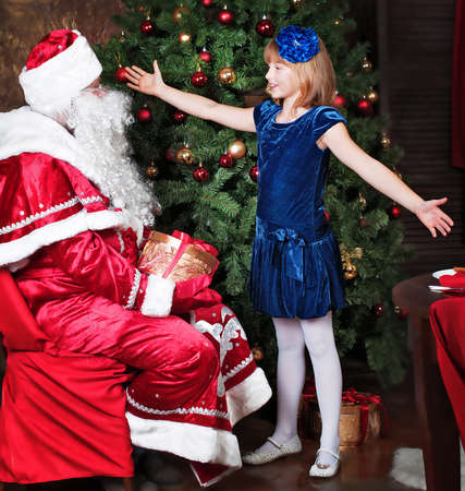 poems: girl says poems Santa Claus Stock Photo