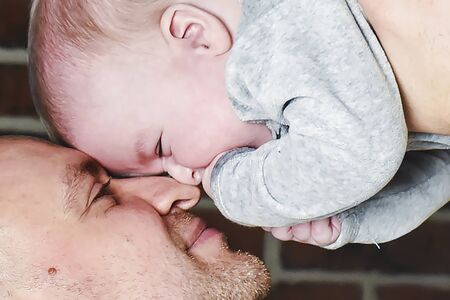 tenderly: father tenderly embraces her young child Stock Photo