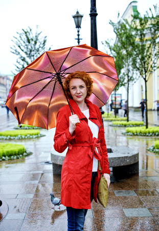 young woman with umbrella in the city