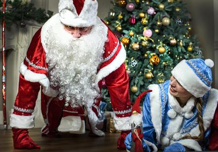 snegurochka: Russian Christmas characters: Ded Moroz (Santa) and Snegurochka (snow girl) around the Christmas tree