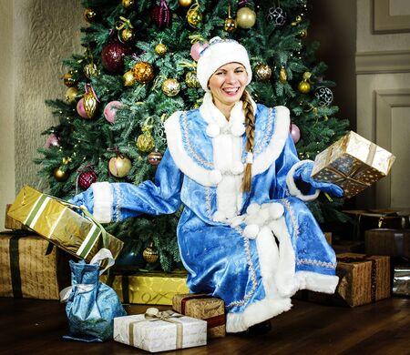 snegurochka: Russian Christmas characters:  Snegurochka (snow girl) around the Christmas tree Stock Photo