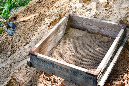 Sieve for sifting sand and stones during construction. Standard-Bild