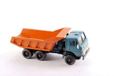 Basis: Collection scale model of the Dumper truck. The model is made of metal. For a basis of model the machine issued in the last century in Russia is taken. Stock Photo