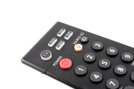 The button of power on a remote control panel of red color photo
