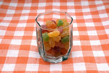 viands: Glass with sugar candies in powdered sugar