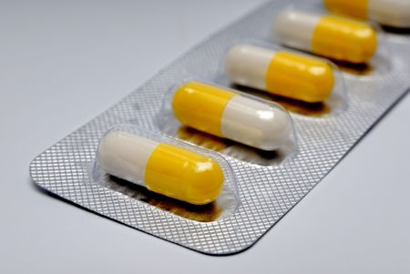 Capsules with a medicine in packing, tablets photo