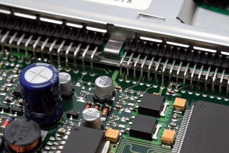 The printed-circuit-board with computer chips resistors and condensers Stock Photo