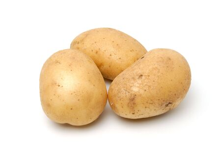 Three baking potatoes shot from a low angle. Stock Photo - 3204230