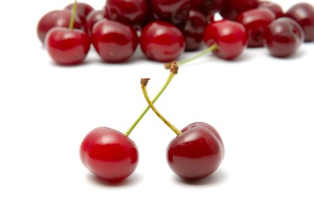 Red ripe cherry on a white background photo