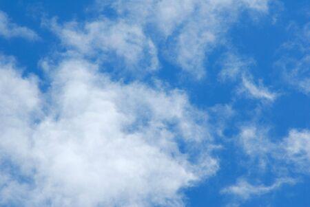 Cumulus white clouds in the dark blue sky