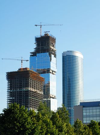 Construction of skyscrapers. Office high-altitude buildings on a background of the sky. photo