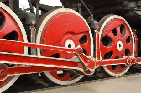 A close-up view of several big wheels from a very old locomotive.