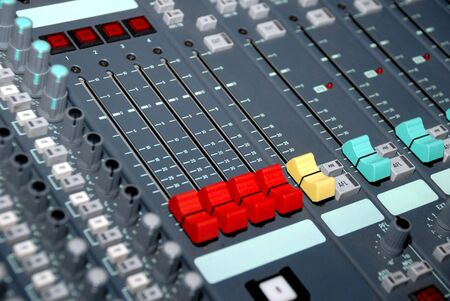 Audio mixing console in a recording studio. Faders and knobs of a sound mixer. Stock Photo