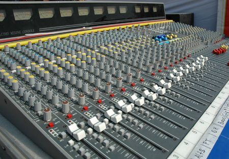 recordings: Audio mixing console in a recording studio. Faders and knobs of a sound mixer. Stock Photo
