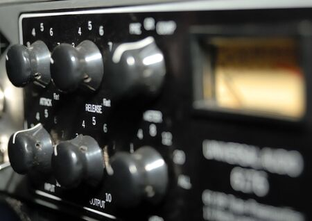 electric mixer: Audio effects processors in a rack. Sound Recording Equipment (Media Equipment). Recording studio.