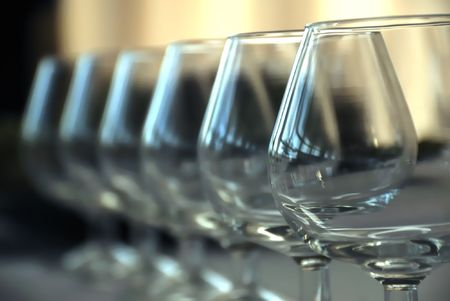 Wineglass against blurry background. Grouping of glasses. photo