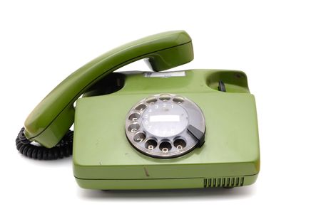 analogue: Old analogue disk phone on a white background Stock Photo