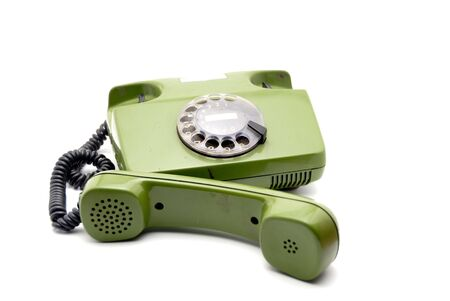 Old analogue disk phone on a white background Stock Photo