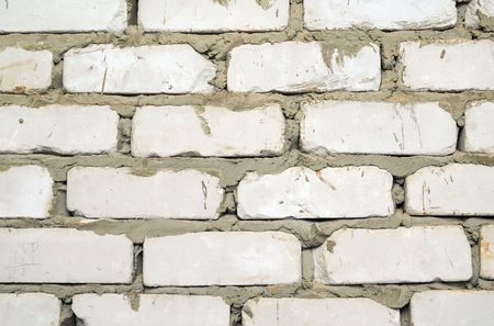 inaccurate: Brick wall. A bricklaying fragment. Inaccurate work. Stock Photo