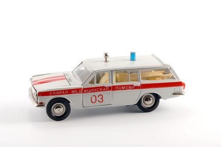 Collection  scale model of the ambulance car on a light background