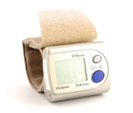 Modern digital blood pressure measurement equipment on a white background photo