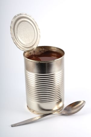 The open metal can on a light grey background photo
