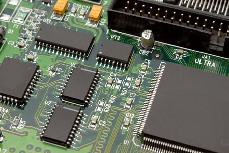 The printed-circuit-board with computer chips resistors and condensers photo
