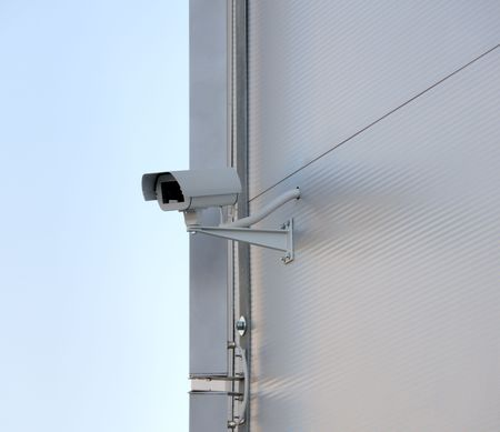 Surveillance security camera on facade.  Big brother is watching you. Stock Photo - 6369056