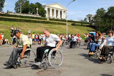 administer: Volgograd, Russia - August 06, 2008 - City Day holiday. Arrival of invalids on wheelchair.
