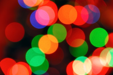 Color photo of blurred Christmas lights at night photo