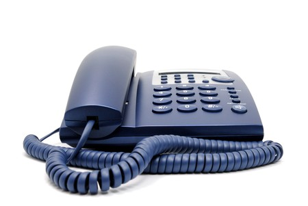 Modern blue business office telephone isolated on a white background. Stock Photo - 7528390