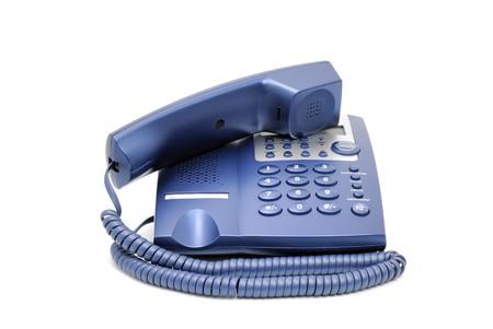 repondre au telephone: T�l�phone de bureau entreprise bleu moderne isol� sur un fond blanc.  Banque d'images