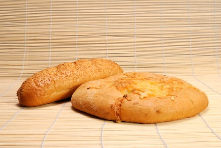 French baguette and Round flat Bread with cheese photo