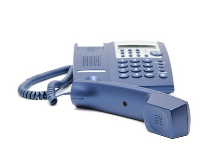 Modern blue business office telephone isolated on a white background. photo