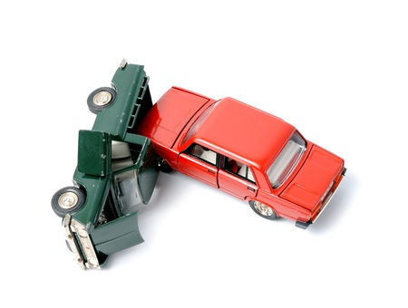 car wreck: Toy cars in accident on a white background Stock Photo